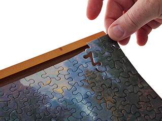 How to frame a jigsaw puzzle puzzlewarehouse many people like to frame completed puzzles for display there are many ways to do this yourself or an easy solution is to take it to your local craft or solutioingenieria Gallery